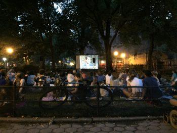 Neighbors enjoying the movie.